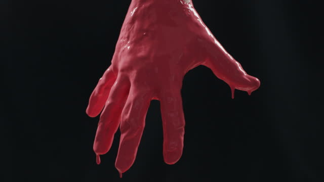 Human hand covered with paint