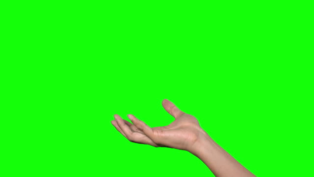 human hand on green background. human hand on green background. gripping stock videos & royalty-free footage