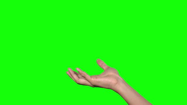 human hand on green background. - avvicinarsi video stock e b–roll