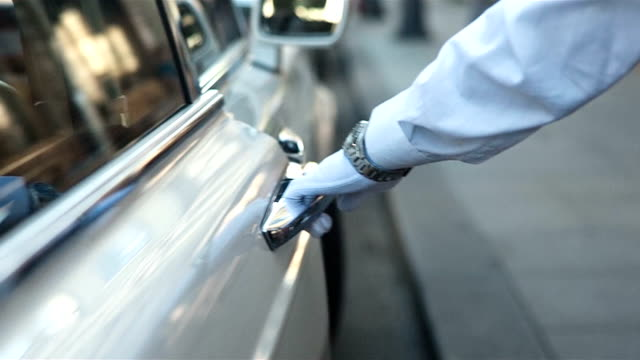 Human Hand Opening Car Door Close up shot of male hand in a glove opening door of a white luxury car glove stock videos & royalty-free footage