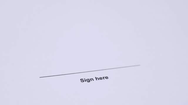 Human hand signing contract video