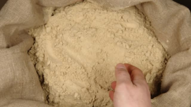 TOP VIEW: Human hand takes a pinch of a ginger powder in a sac TOP VIEW: Human hand takes a pinch of a ginger powder in a sac sac stock videos & royalty-free footage