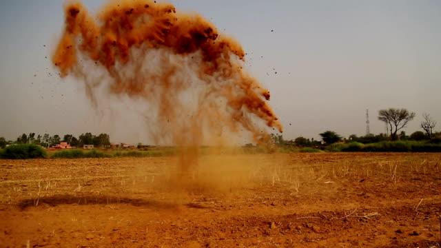 Human hand throwing sand in desert video