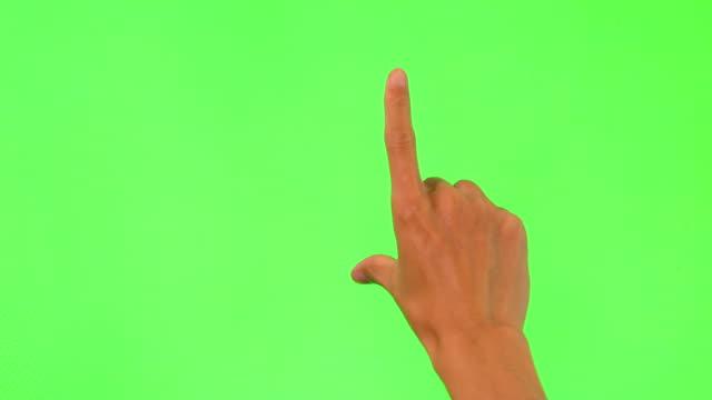 Human hand touching green Screen Human hand touching green Screen pinching stock videos & royalty-free footage