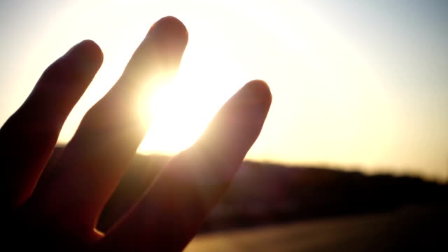 Human hand with light of sun video