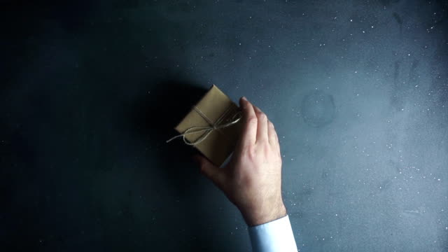 Human hands holding gift box