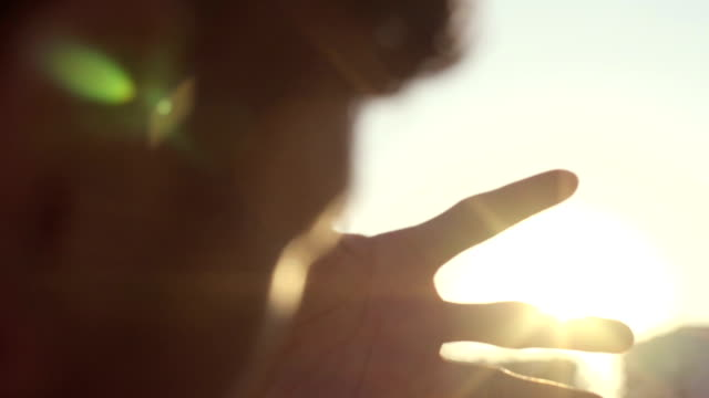 Human Hands Playing with Sunbeams During Sunrise video