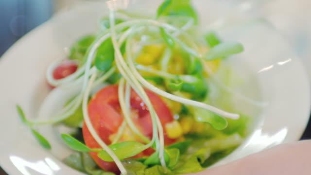 Human Hands Take a Salad with Salad Cream , healthy food Human Hands Take a Salad with Salad Cream , healthy food 4K(UHD) tomato salad stock videos & royalty-free footage