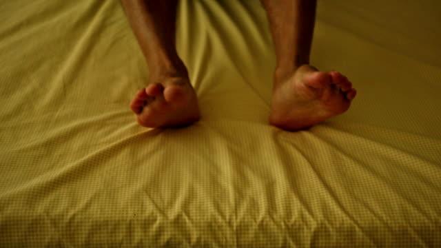 Human leg on bed video