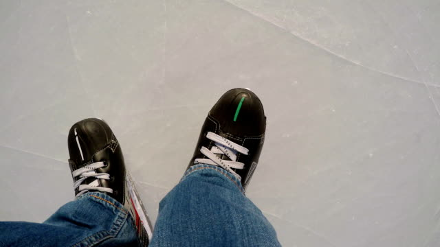 TOP VIEW: Human legs in a skates on a ice video