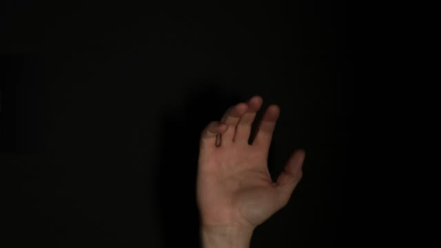 human male palm isolated on black background. close up. - palm of hand stock videos & royalty-free footage