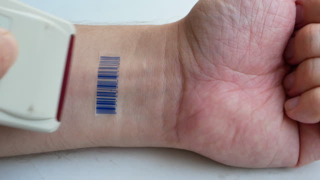 human with implant micro chip scanning barcode imprinted on his hand. future technology identification or human as a goods concept human with implant micro chip scanning barcode imprinted on his hand. future technology identification or human as a goods concept. 4k UHD video footage implant stock videos & royalty-free footage