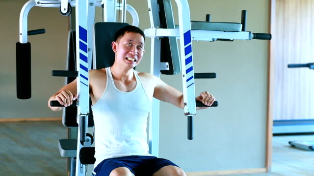 Humor of Asian man is exercising at the gym with funny and humor expression video
