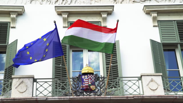 Hungarian and European Union Flag Waving at Sándor in Budapest The Sándor is the official residence of the President of Hungary. Real time shot made in 4K/Ultra High Definition. hungary stock videos & royalty-free footage