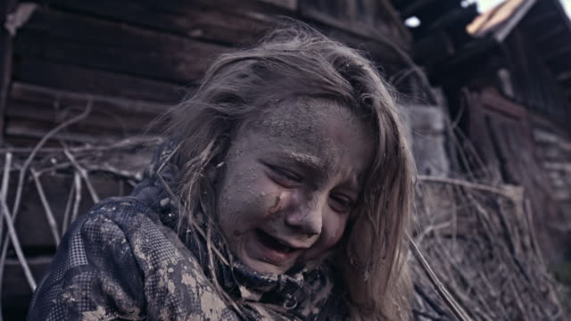 hungry homeless child near the ruins. refugees - fuggitivo video stock e b–roll