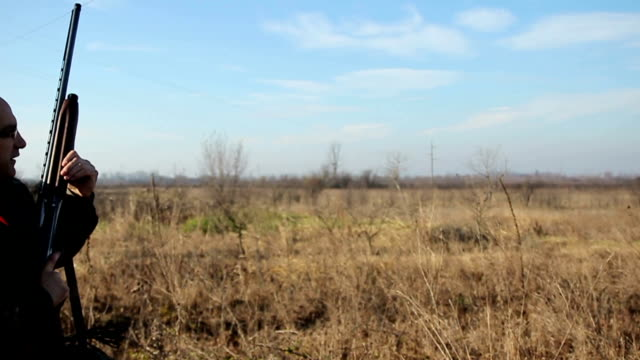 Hunter shooting at a target,slow motion video