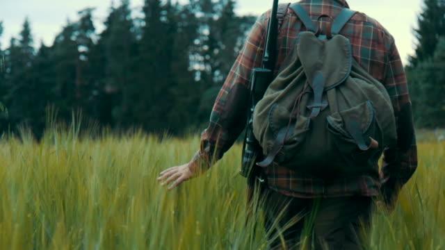 Hunter walking on a field