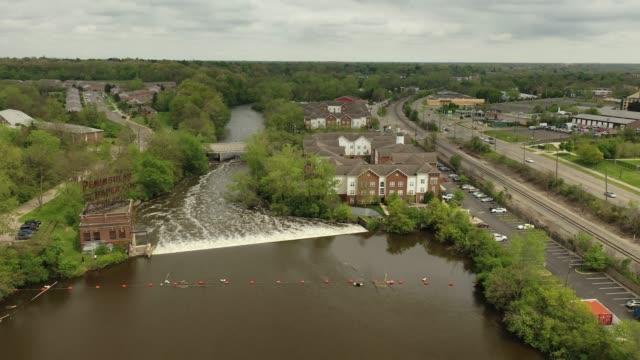 Huron River and the Peninsular Paper Dam in Ypsilanti, Michigan Aerial Video