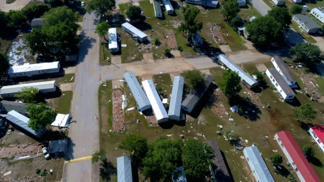 hurricane harvey hits small town of la grange , texas and massive destruction below as aerial drone flys over the damage - gulf coast states stock videos & royalty-free footage