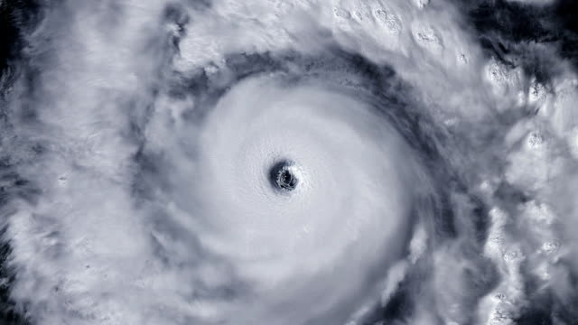 Hurricane storm tornado over the Earth from space, satellite view. Zoom video