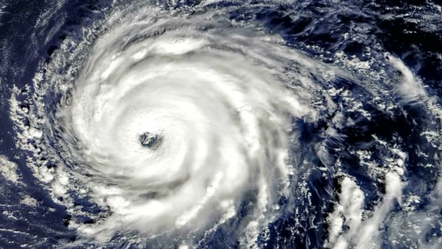 hurricane storm tornado, satellite view. some elements of this video furnished by nasa. - uragano video stock e b–roll