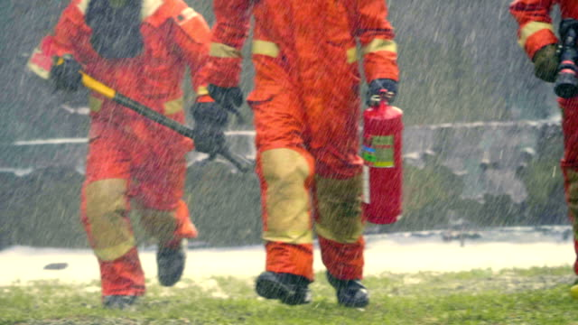 Hurry Fire Fighter Fire extinguisher rescue worker stock videos & royalty-free footage