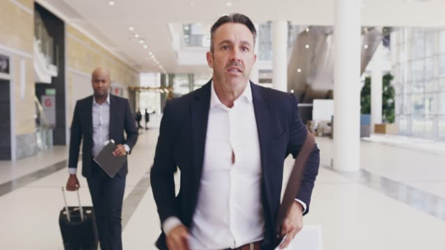 vídeos de stock e filmes b-roll de hurrying on towards his next big opportunity - important