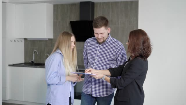 Husband and wife buying new modern apartment with beautiful interior