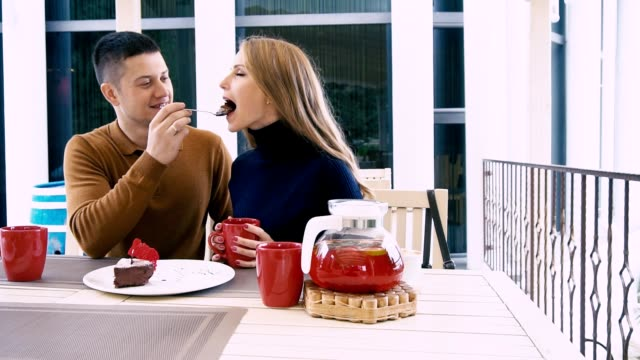husband and wife drink tea eat dessert in the restaurant video
