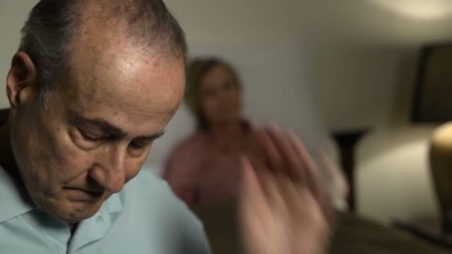 Husband Expresses Concern for Sick Wife - CU video