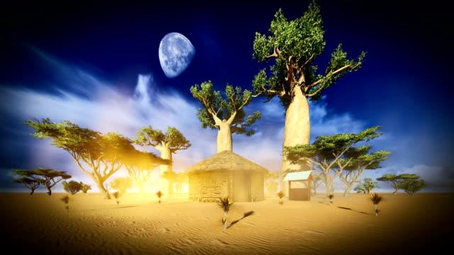 Hut between baobabs video