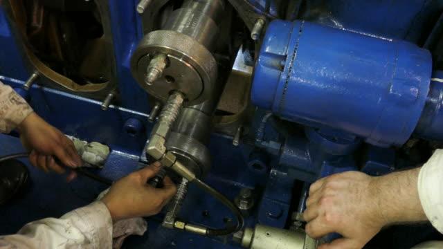 hydraulic jack - tubo flessibile video stock e b–roll