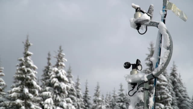 Hydro meteorological center Hydro meteorological center. Wind speed meter anemometer installed in the mountains. Meteorological equipment against the background of trees in the snow in winter meteorology stock videos & royalty-free footage
