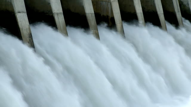 Hydroelectric Dam spillway Large quantity of water rushing over the spillway of a hydroelectric dam turbine stock videos & royalty-free footage