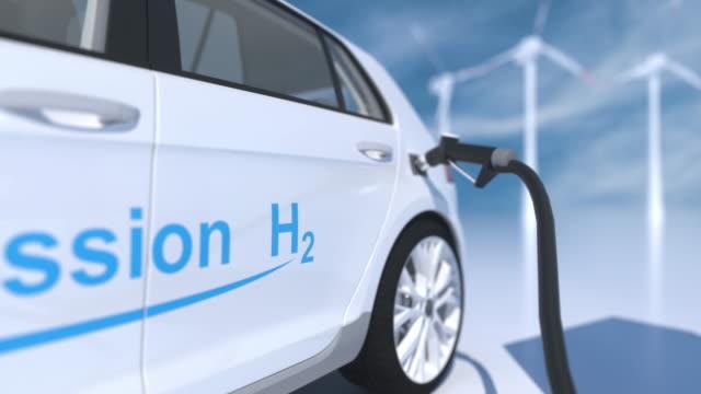 hydrogen logo on gas stations fuel dispenser. h2-verbrennungsmotor für emissionsfreien umweltfreundlichen transport. - wasserstoff stock-videos und b-roll-filmmaterial