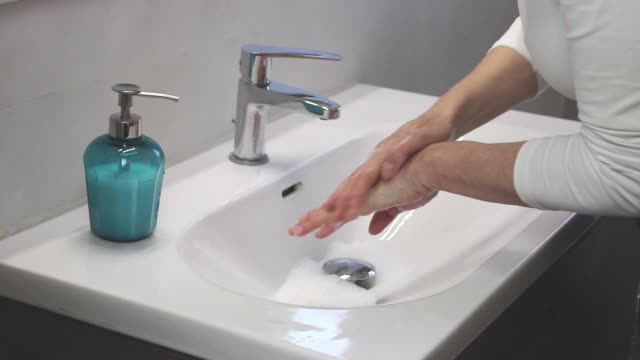 hygiene concept. washing hands with soap - igiene video stock e b–roll