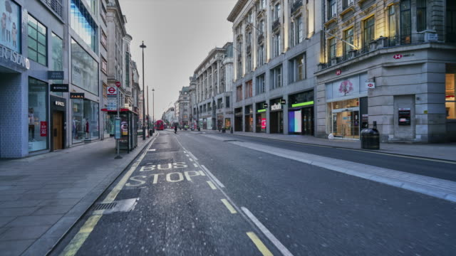 A hyper lapse along Oxford Street, Central London UK,  devoid of people and traffic at dusk during the Covid-19 lockdown, April 2020 lockdown viewpoint stock videos & royalty-free footage