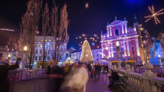 MS Hyper lapse crowd enjoying Christmas tree and lights in town square at night,Ljubljana,Slovenia