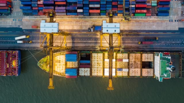 Hyper lapse of international port with Crane loading containers in import export business logistics Hyper lapse of international port with Crane loading containers in import export business logistics commercial dock stock videos & royalty-free footage
