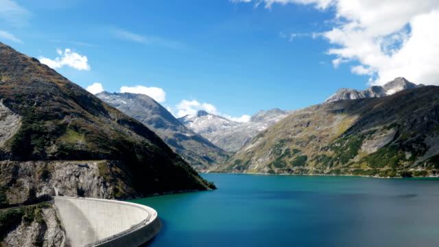 Hyper lapse of Kolnbrein Dam and Kolnbreinspeicher lake in Carinthia, Austria. Hyperlapse of Kolnbrein Dam in Carinthia, Austria. renewable energy stock videos & royalty-free footage