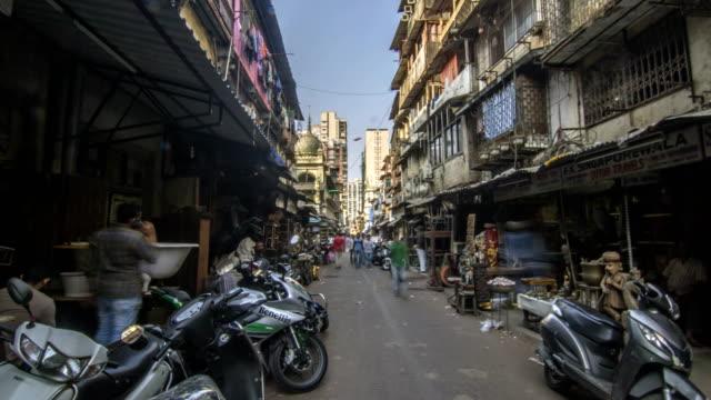 hyper lapse of small lane in a old part of the mumbai city called chor bazaar (shor bazaar) - india video stock e b–roll