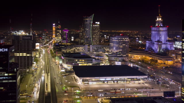 hyper lapse of the warsaw city center in the night. - polonia video stock e b–roll