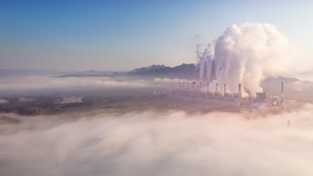Hyper lapse video 4K, Steam and mist over coal power plant Mae Moh Lampang at morning with fog, Air pollution.