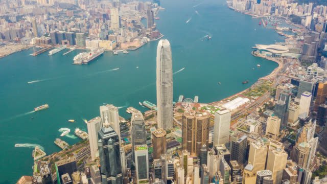hyperlapse aerial view of cityscape downtown traffic in victoria harbour at hong kong china - hyperlapse video stock e b–roll