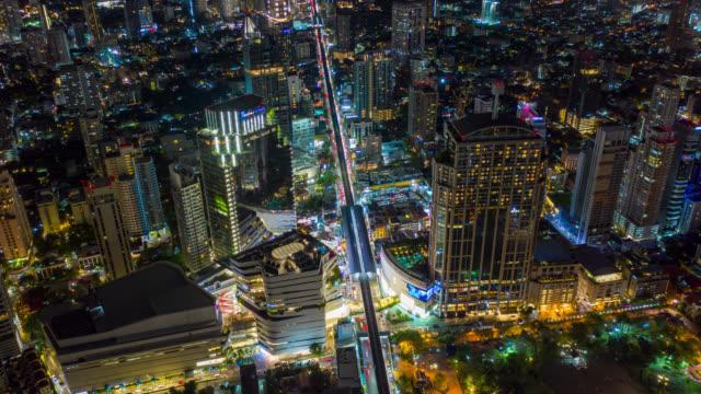 hyperlapse aerial view of the bangkok landmark financial business district with skyscraper on sukhumvit district in bangkok city at night - tajlandia filmów i materiałów b-roll