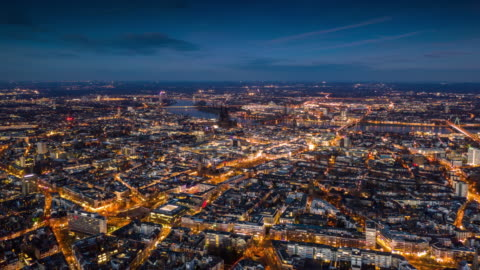 Hyperlapse : Cologne Cityscape at Dusk Aerial hyperlapse of cologne cityscape illuminated at dusk. Germany - Europe europe stock videos & royalty-free footage