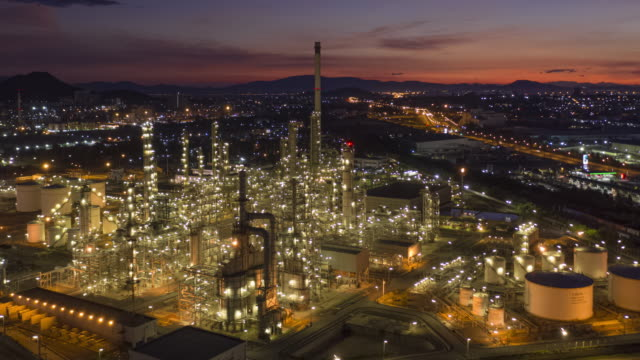 Hyperlapse of Oil and gas industry petroleum refinery in twilight time 4k aerial view Hyperlapse or drone timelapse of Oil and gas industry petroleum refinery in twilight time gas pipe stock videos & royalty-free footage