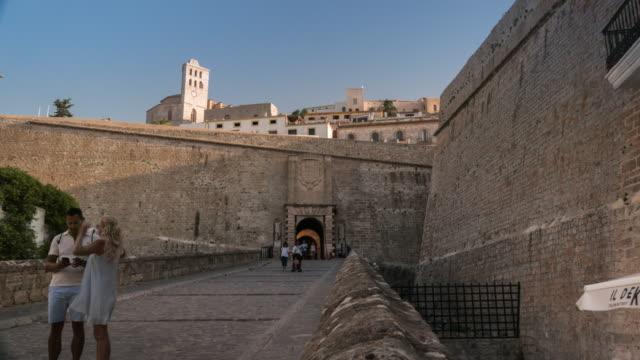 hyperlapse of the entrance of historic center in ibiza spain at sunset - ibiza filmów i materiałów b-roll