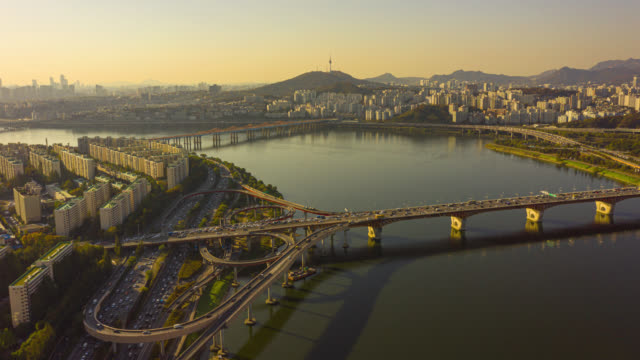 Hyperlapse or Dronelapse Aerial view of Seoul downtown city skyline with vehicle on expressway and bridge cross over Han river in Seoul city, South Korea. Hyperlapse or Dronelapse Aerial view of Seoul downtown city skyline with vehicle on expressway and bridge cross over Han river in Seoul city, South Korea. south korea stock videos & royalty-free footage