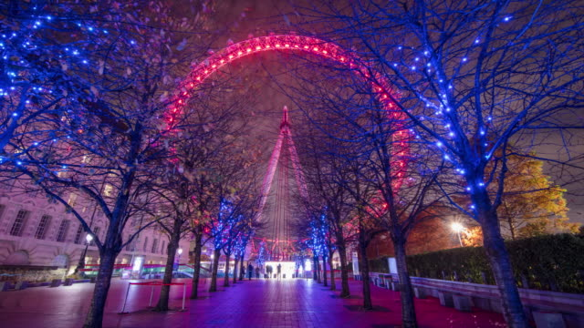 t/l hyperlapse shot of the london eye at night - london architecture stock videos & royalty-free footage